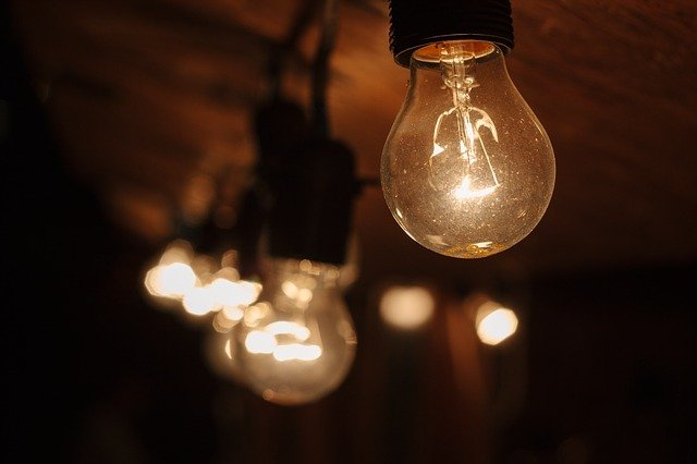 Bulbs glow in a dark room