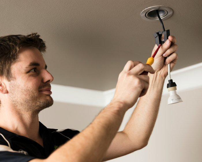 Electrician installing an LED