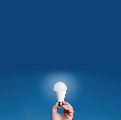 A hand holding an LED globe